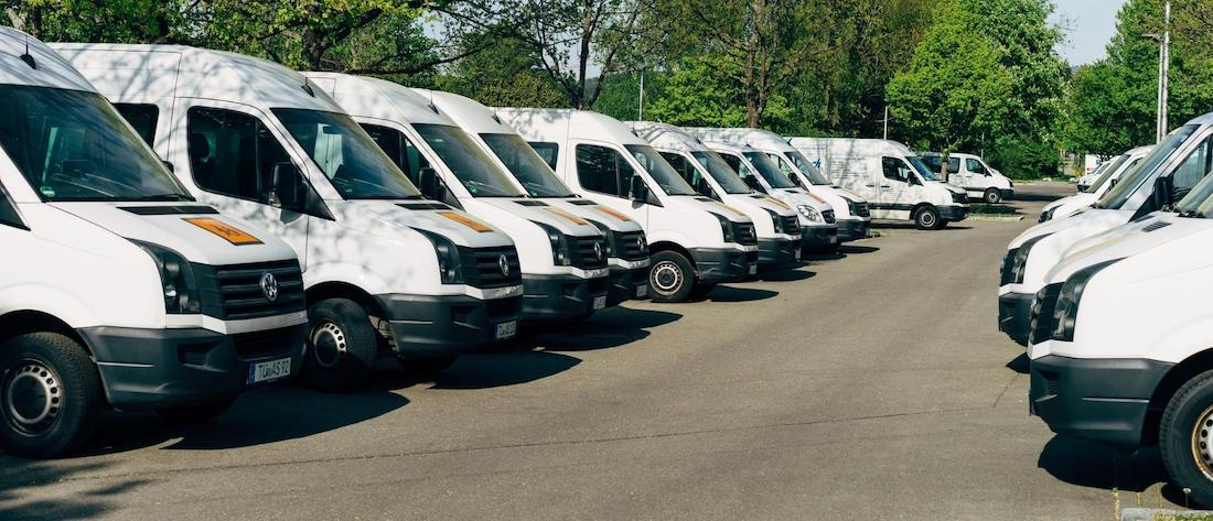 Photo of a fleet of delivery vehicles to help describe what is fleet management