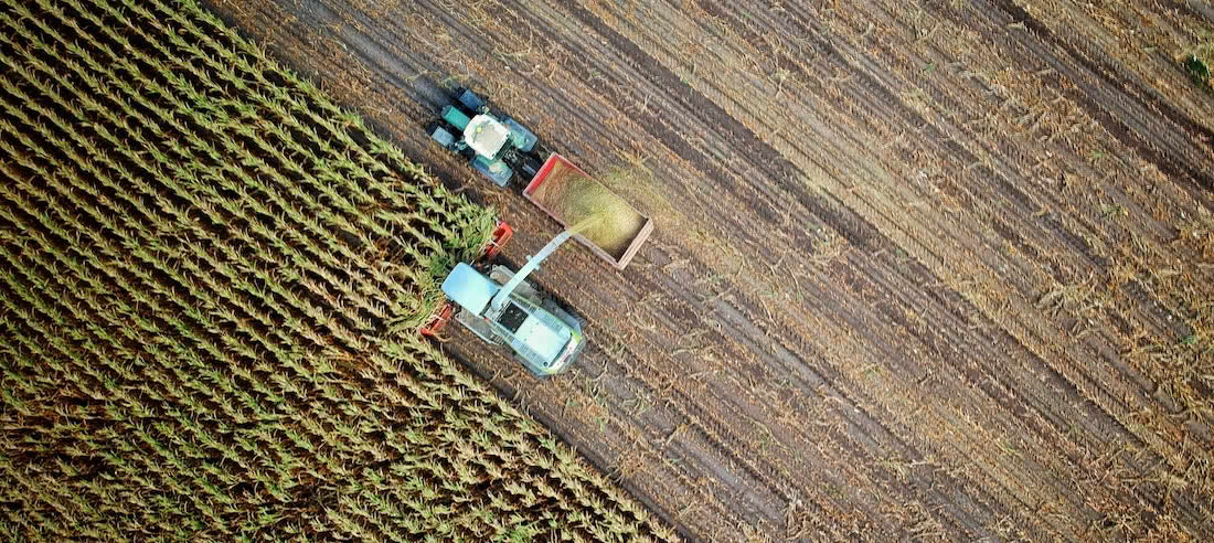 Aerial photo of agricultural machinery harvesting crops